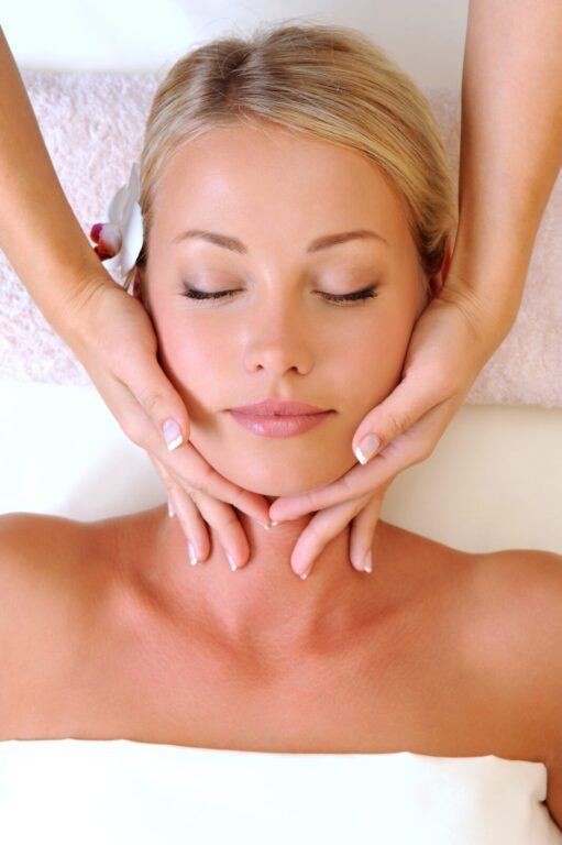 Facial cleansing for beautiful young woman in beauty salon